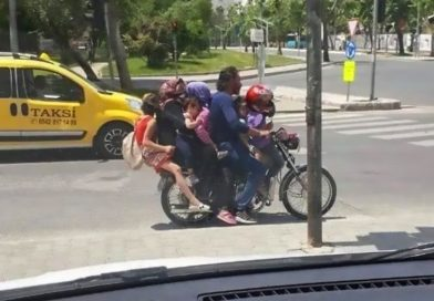 Family Of 7 On 1 Motorbike Without Helmets On Busy Road