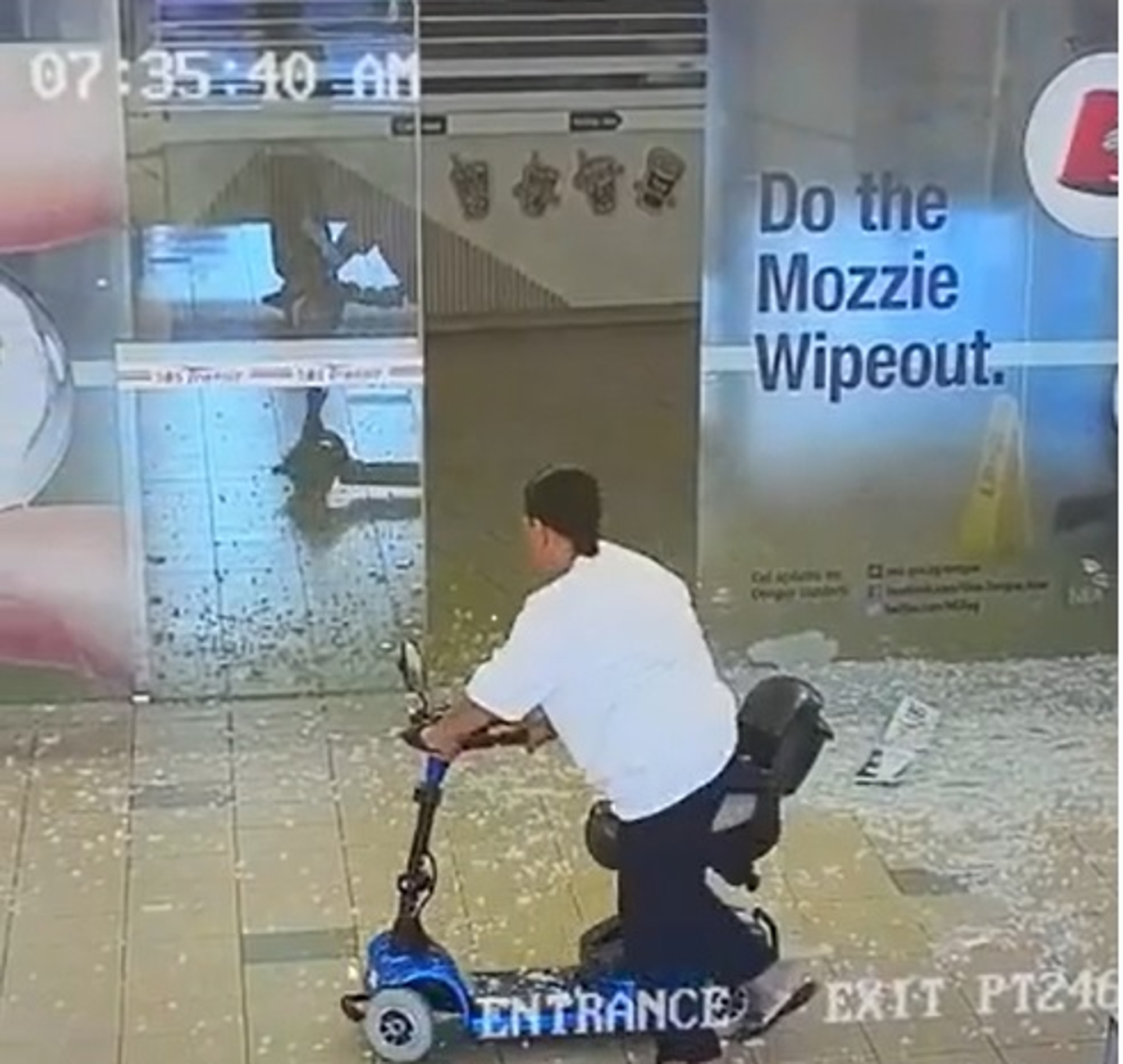 Mobility Scooter Woman Crashes Through Glass Door Viraltab