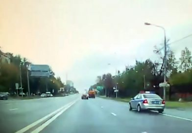 Cop Car With Sirens Crashes Into HGV, Flips Through Air