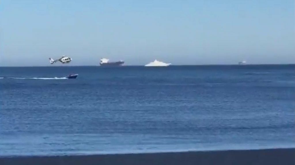 spanish coasdtguards helicopter chases migrant boat