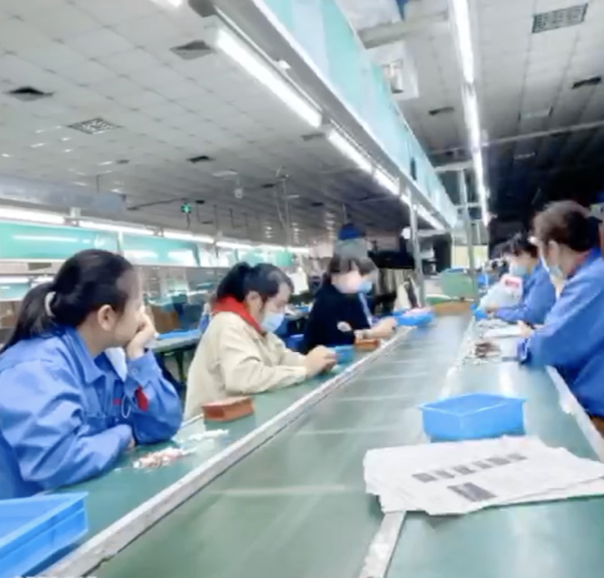 Chinese Factory Staff Sit Around As Global Orders Dry Up